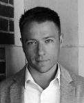 Head shot of Adam Lippert